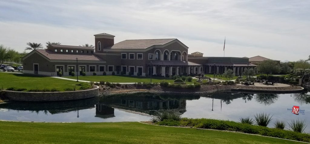 rear view of CantaMia's Clubhouse with lake